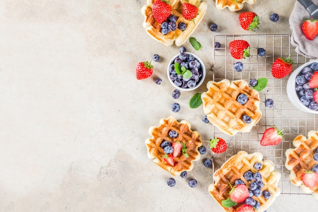 Sweet homemade belgian waffles with berries