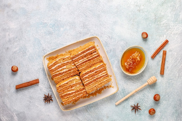 Sweet homemade layered honey cake with spices and nuts.