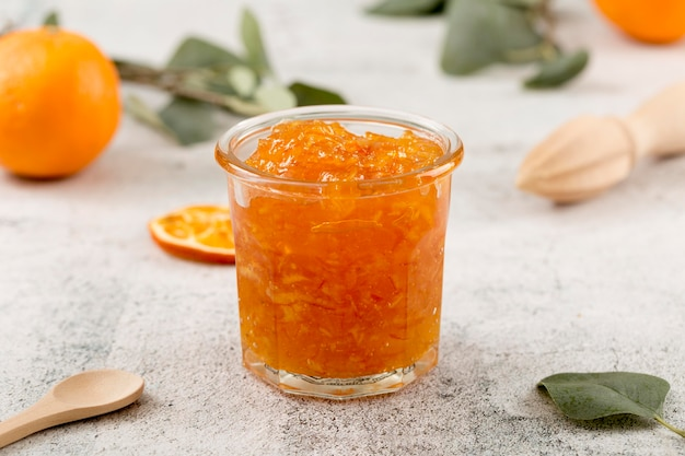 Sweet homemade natural orange jam in a glass