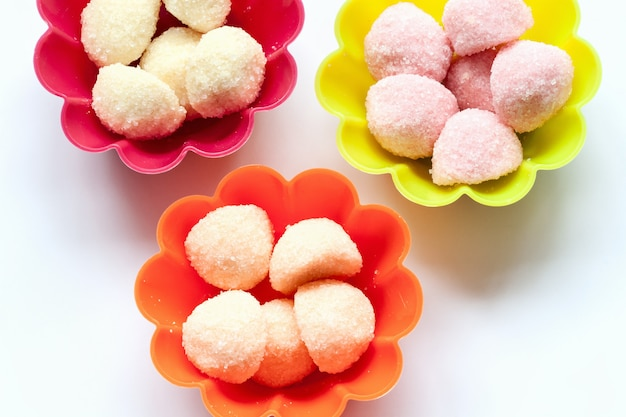 Sweet jelly candies in cup cake cases on white