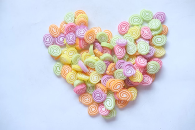 Sweet jelly in heart shape on white background