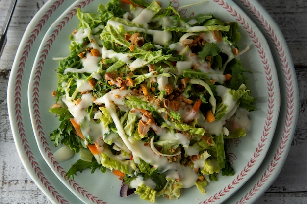 Sweet kale salad - healthy vegetarian salad with cabbage, eggs, greens, carrots and mayonnaise.