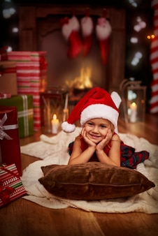Sweet little santa claus relaxing on christmas eve