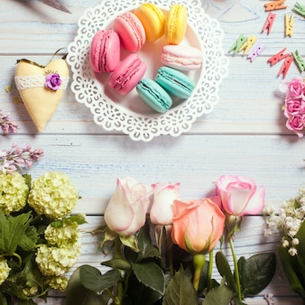 Sweet macarons and flowers - preparation of present