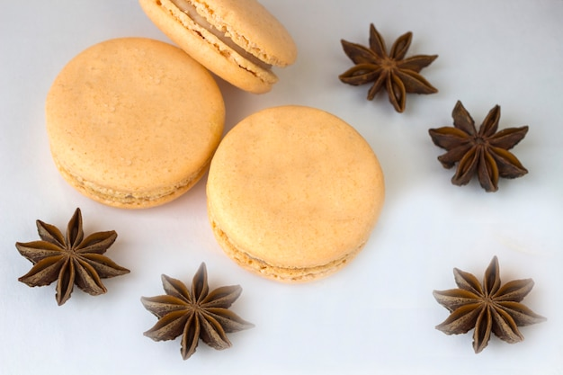 Sweet macarons, spices anise and cinnamon sticks