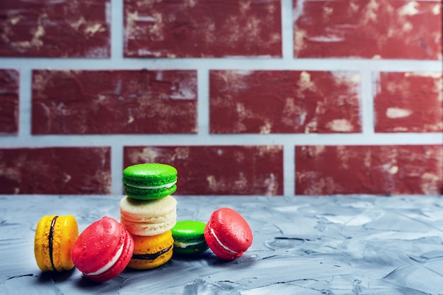Sweet macaroons on stone background with copy space. holiday time concept