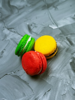Sweet macaroons on stone background with copy space. top view, holiday time concept Premium Photo