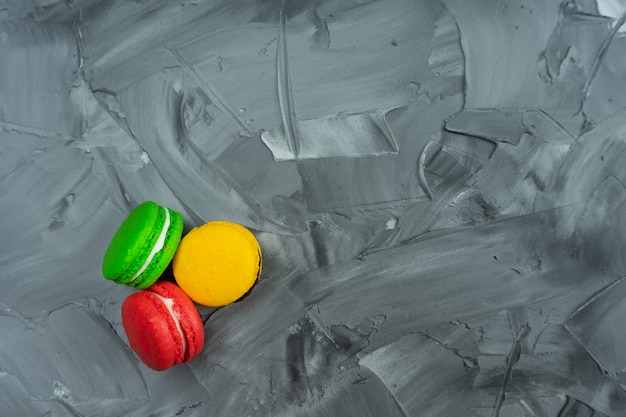Sweet macaroons on stone background with copy space. top view, holiday time concept
