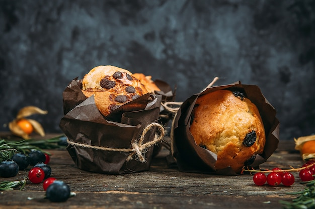 Sweet muffins with chocolate chips and raisins