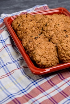 Sweet oatmeal cookies in red tray