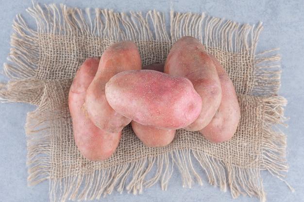 Sweet organic red potatoes on the sack.
