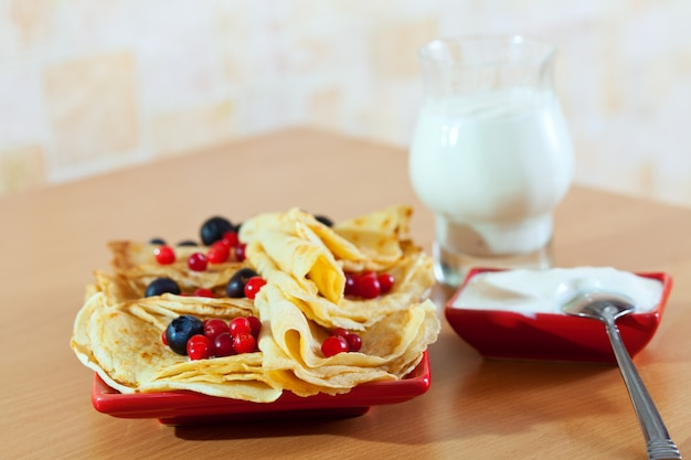 Sweet pancakes with berries and dairy