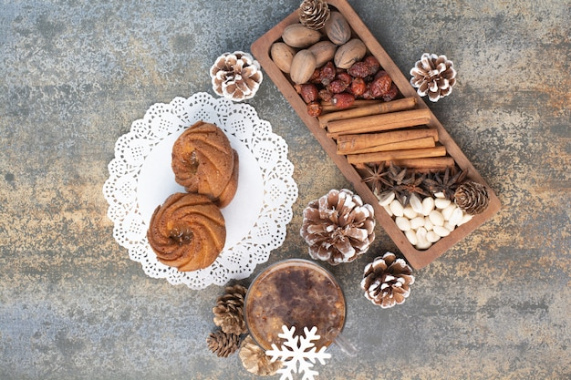 Sweet pastries with pinecones and cup of coffee. high quality photo