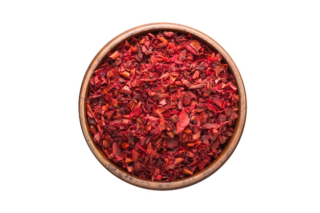 Sweet pepper powder spice in wooden bowl, isolated on white wall. seasoning top view