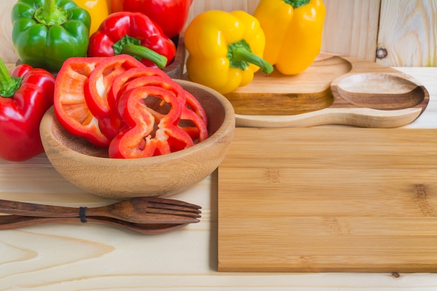 Sweet peppers on wooden table background