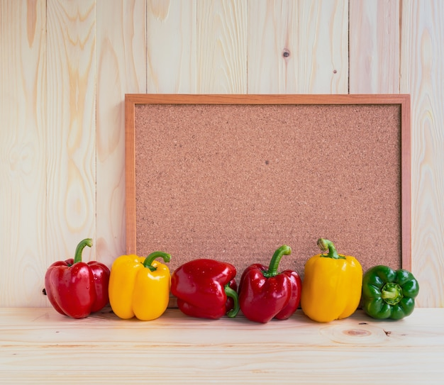 Sweet peppers on wooden table.