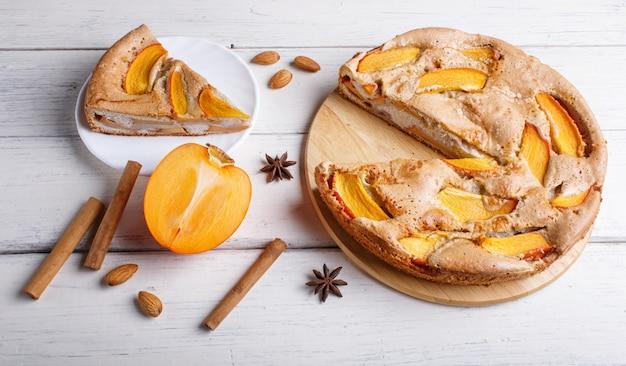 Sweet persimmon pie on wooden.