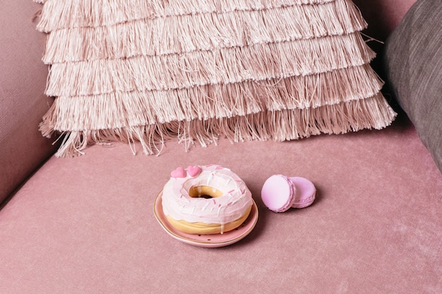 Sweet pink donut on pink