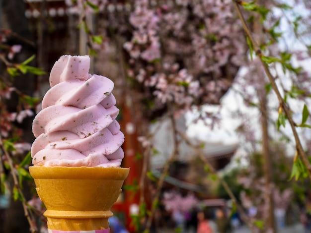 Sweet pink sakura japanese ice cream soft serve cone