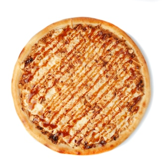 Sweet pizza with butter cream, peanuts, caramel and mozzarella cheese. view from above. white background. isolated.