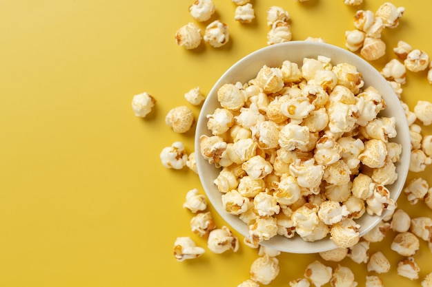 Sweet popcorn on yellow background