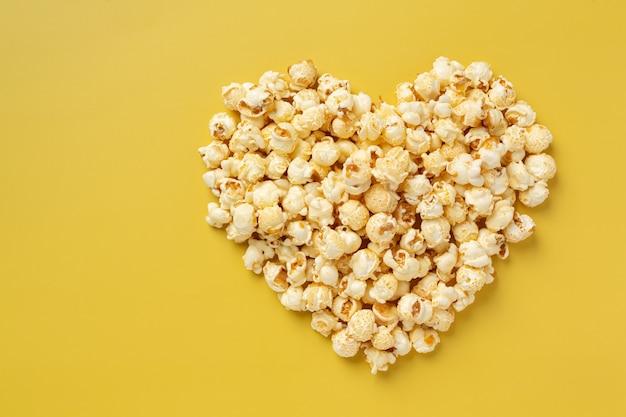 Sweet popcorn on yellow background
