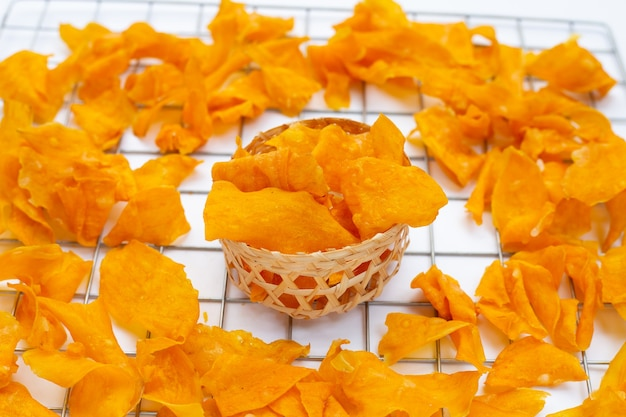 Sweet potato chips with sugar on white background.