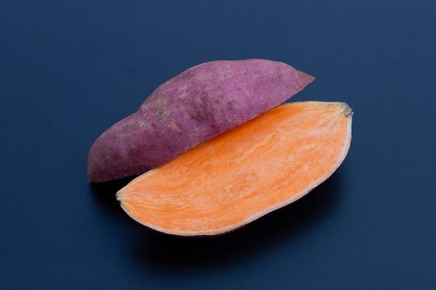 Sweet potato on dark background.