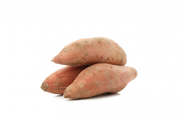 Sweet potatoes isolated on white surface. vegetables