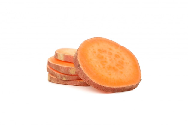 Sweet potatoes slices isolated on white surface