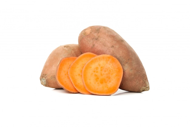 Sweet potatoes and slices isolated on white surface