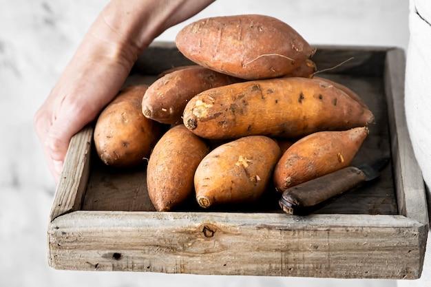 Sweet potatoes in wooden box