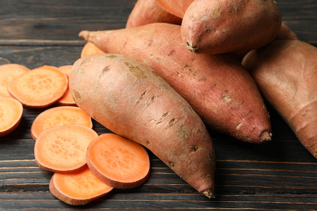 Sweet potatoes on wooden surface