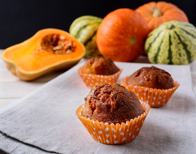 Sweet pumpkin muffins and ripe squashes