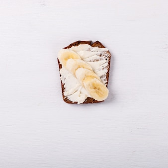 Sweet sandwich with cream-cheese and banana