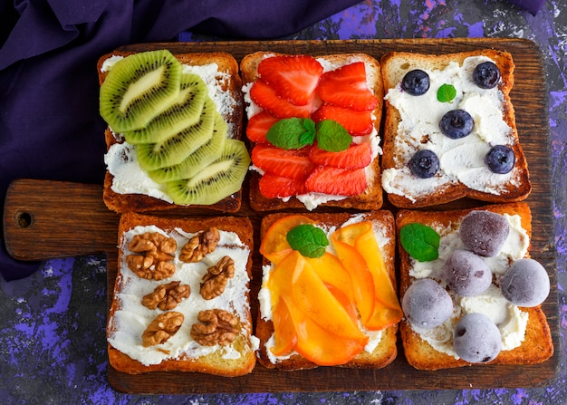 Sweet sandwiches with fruit and soft cheese