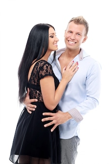 Sweet and sexy couple having a photo session in studio