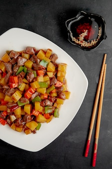 Sweet and sour duck with vegetables and pepper on plate