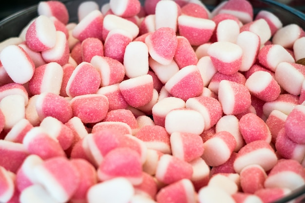 Sweet sugar candies on a street market shop table