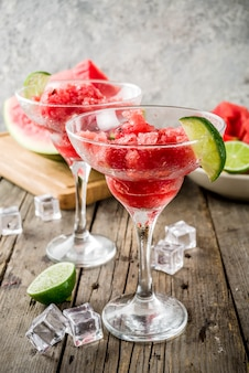 Sweet summer watermelon and lime granita with sliced watermelon and mint