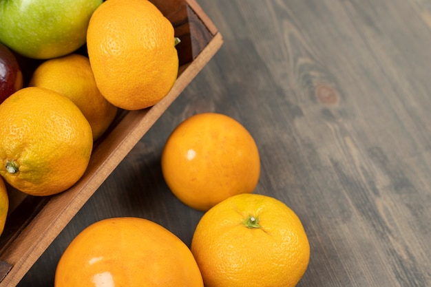 Sweet tangerines or mandarins on a wooden table. high quality photo