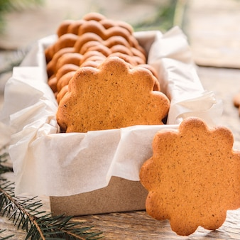 Sweet thin ginger biscuit in gift box on a wooden background