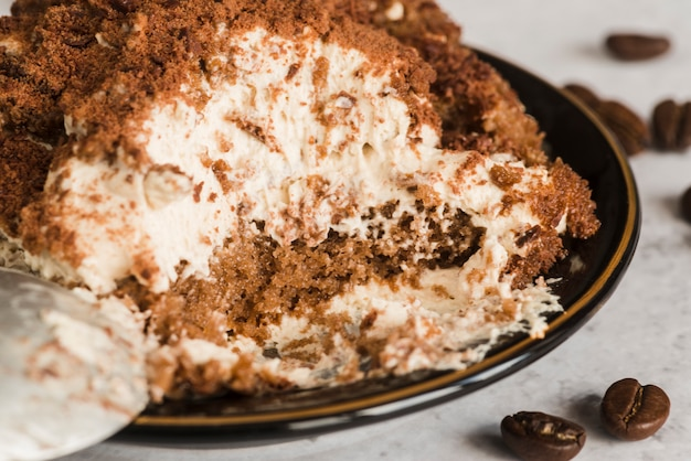 Sweet tiramisu on white table