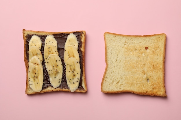 Sweet toast with banana on pink background