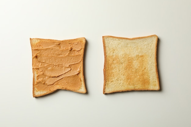 Sweet toast with peanut butter on gray background