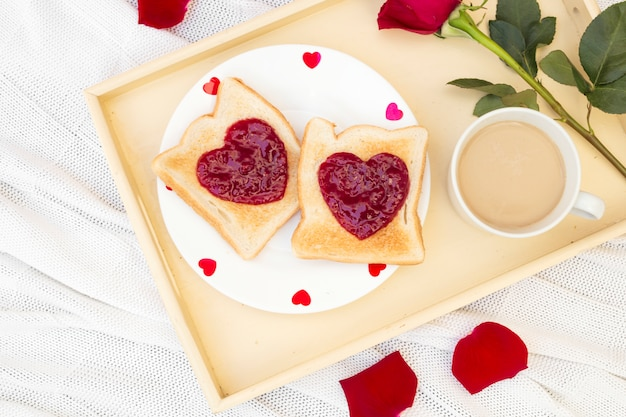 Sweet toasts with coffee on tray