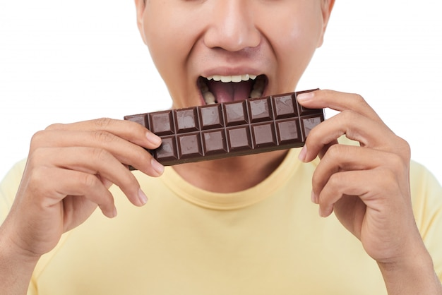 Sweet tooth biting chocolate bar