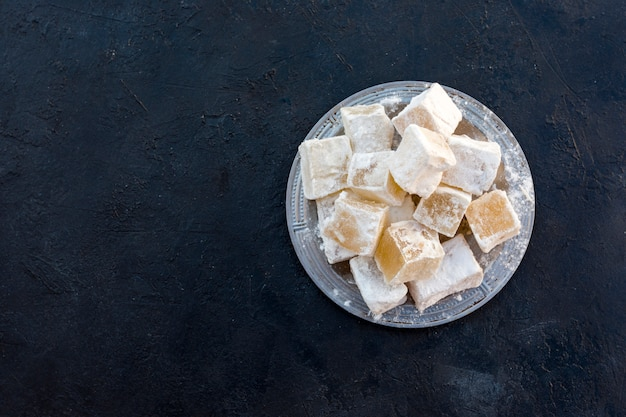 Sweet turkish delight on black table
