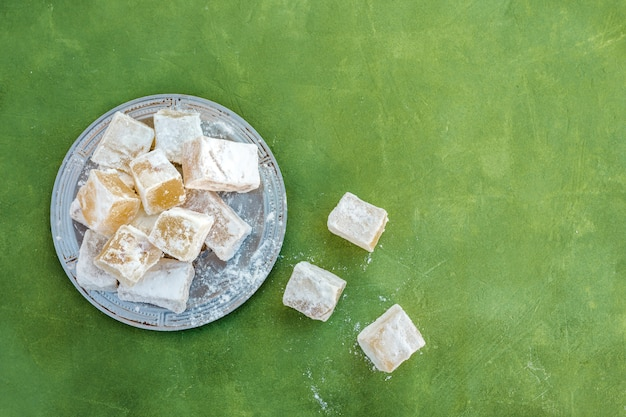 Sweet turkish delight on plate on table