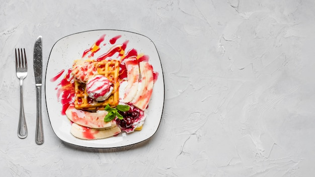 Sweet waffles with bananas copy space